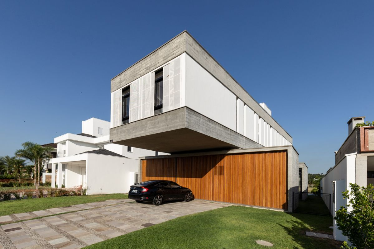 The house is very simple and has a white exterior with gray and wooden accents