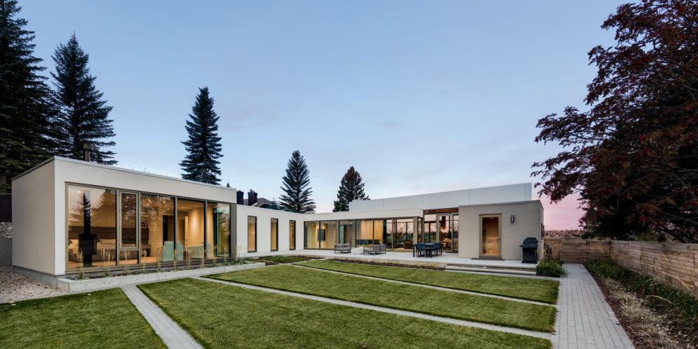 The house has a large backyard surrounded by fences and privacy walls