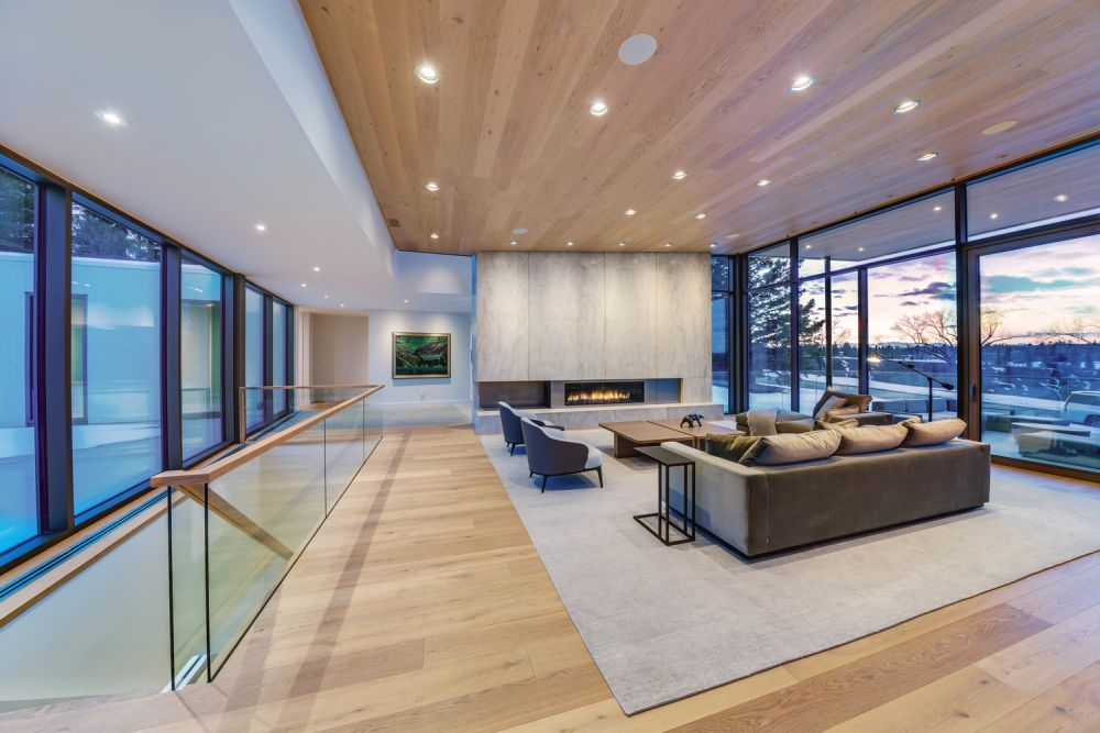 Large windows reveal beautiful views over the river valley and the backyard
