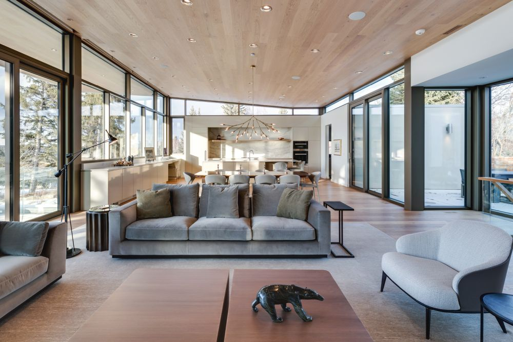 The living areas are framed by windows and sliding doors on almost all sides and has a very open and exposed feel