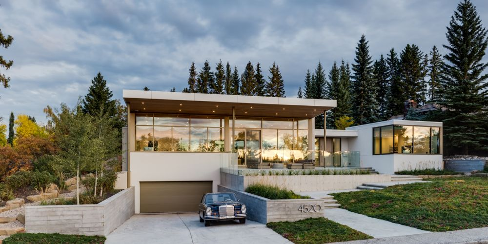 The drive-down garage gives the impression of a taller building without disregarding the height restrictions