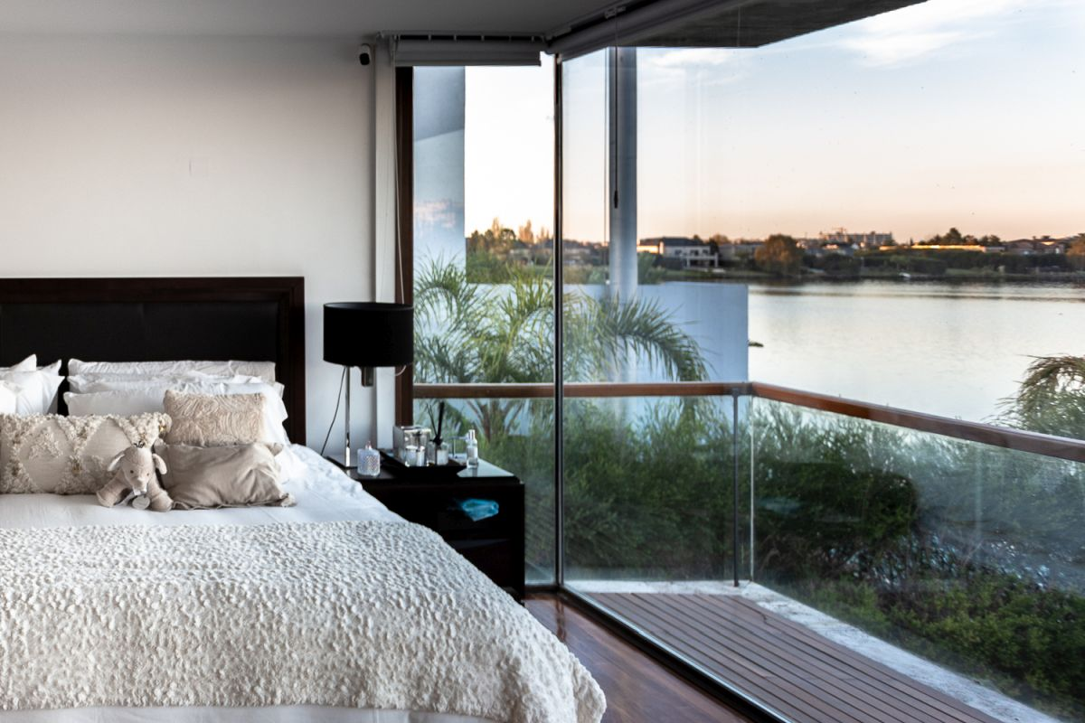 The bedrooms extend onto private balconies and terraces with beautiful views of the lake