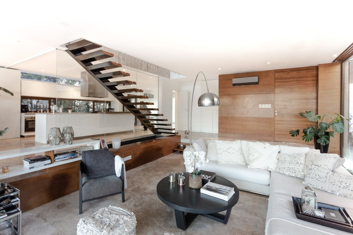 There's a clear distinction between the living room and the kitchen but the two are also connected on a visual level