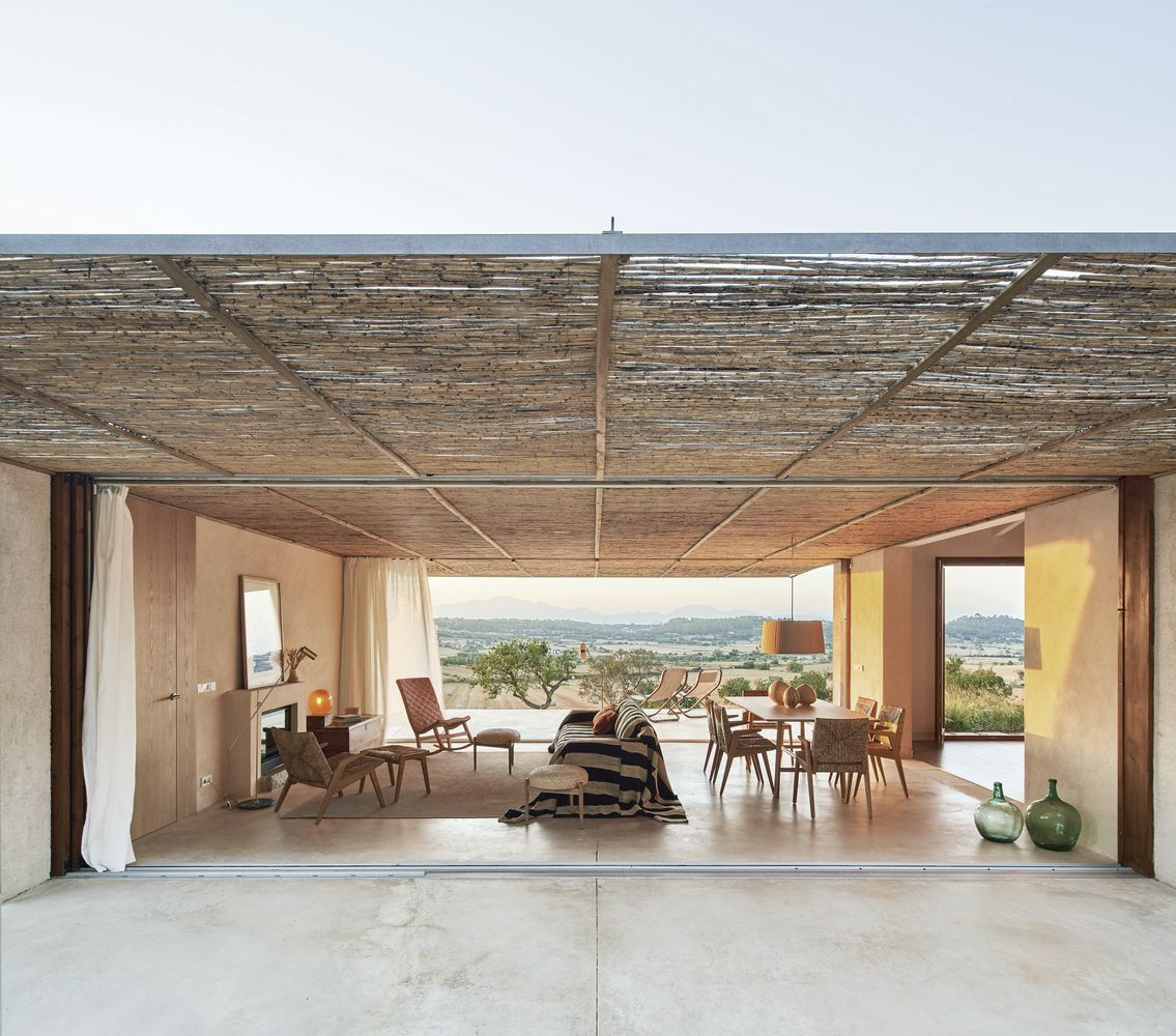 The central living area can be completely open to the exterior and has beautiful shade curtains