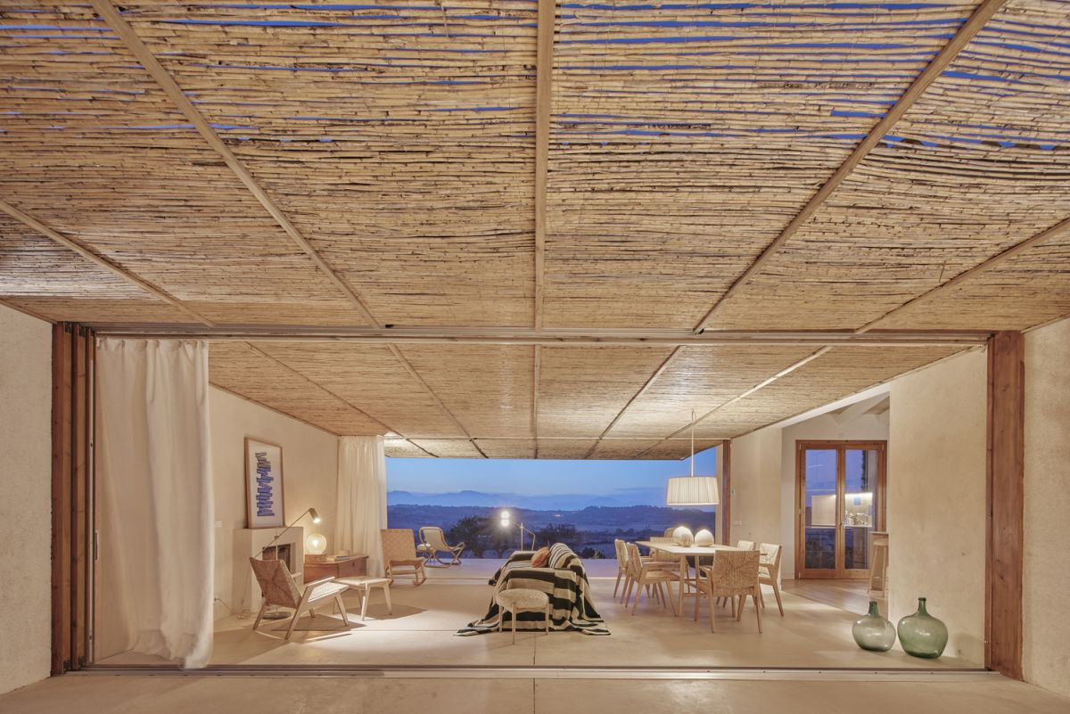 The pergola ceiling in the living area extends outside on both sides