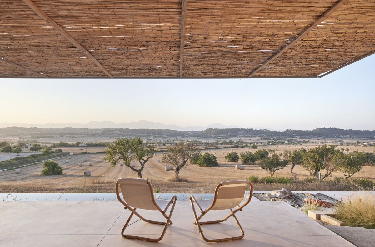 The two covered terraces offer expansive views on opposite sides of the house