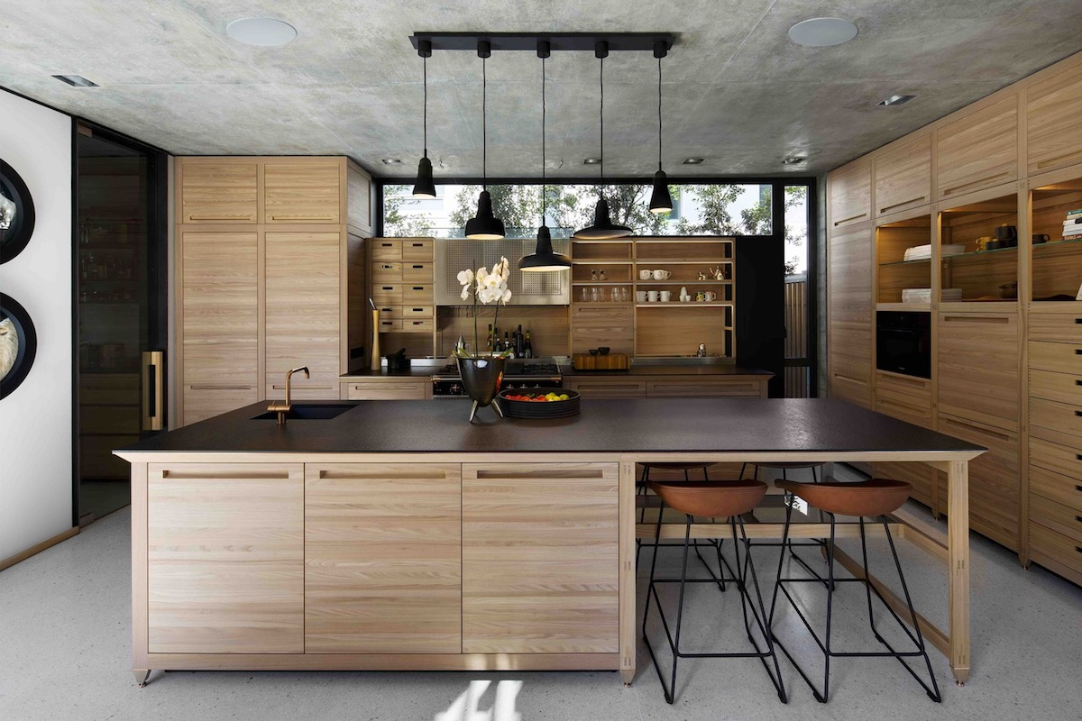 The kitchen island has a bar extension which can also serve as a breakfast table