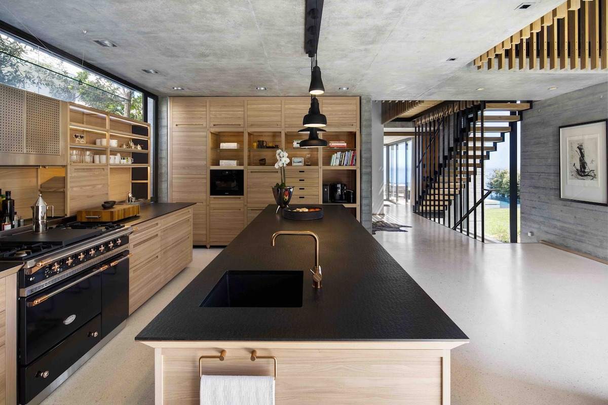 The ceilings are left exposed and unfinished and their ruggedness is balanced out by all the wood