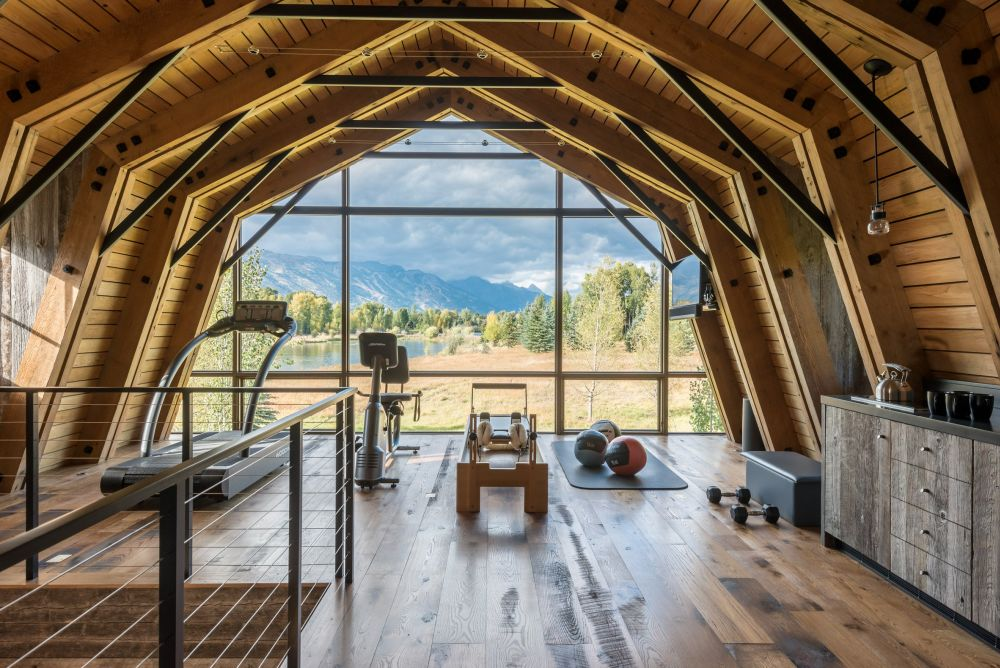 The upper floor is a very cozy workout area with a panoramic views of the surroundings