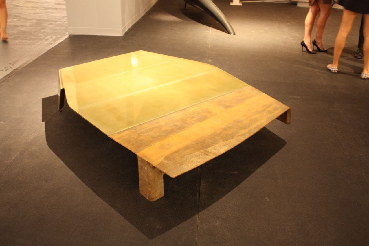 This coffee table from the Carpenter's Workshop Gallery demonstrates that art form doesn't have to limit function. It's not a generic square or rectangular table, but it's highly functional.