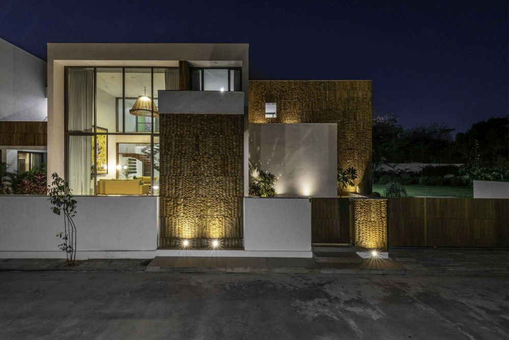 The strategic lighting puts an emphasis on the beautiful texture of the exterior walls
