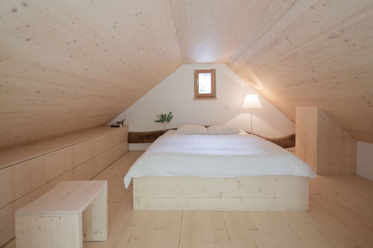 The upstairs area serves as a bedroom and feels a lot like a cozy attic room