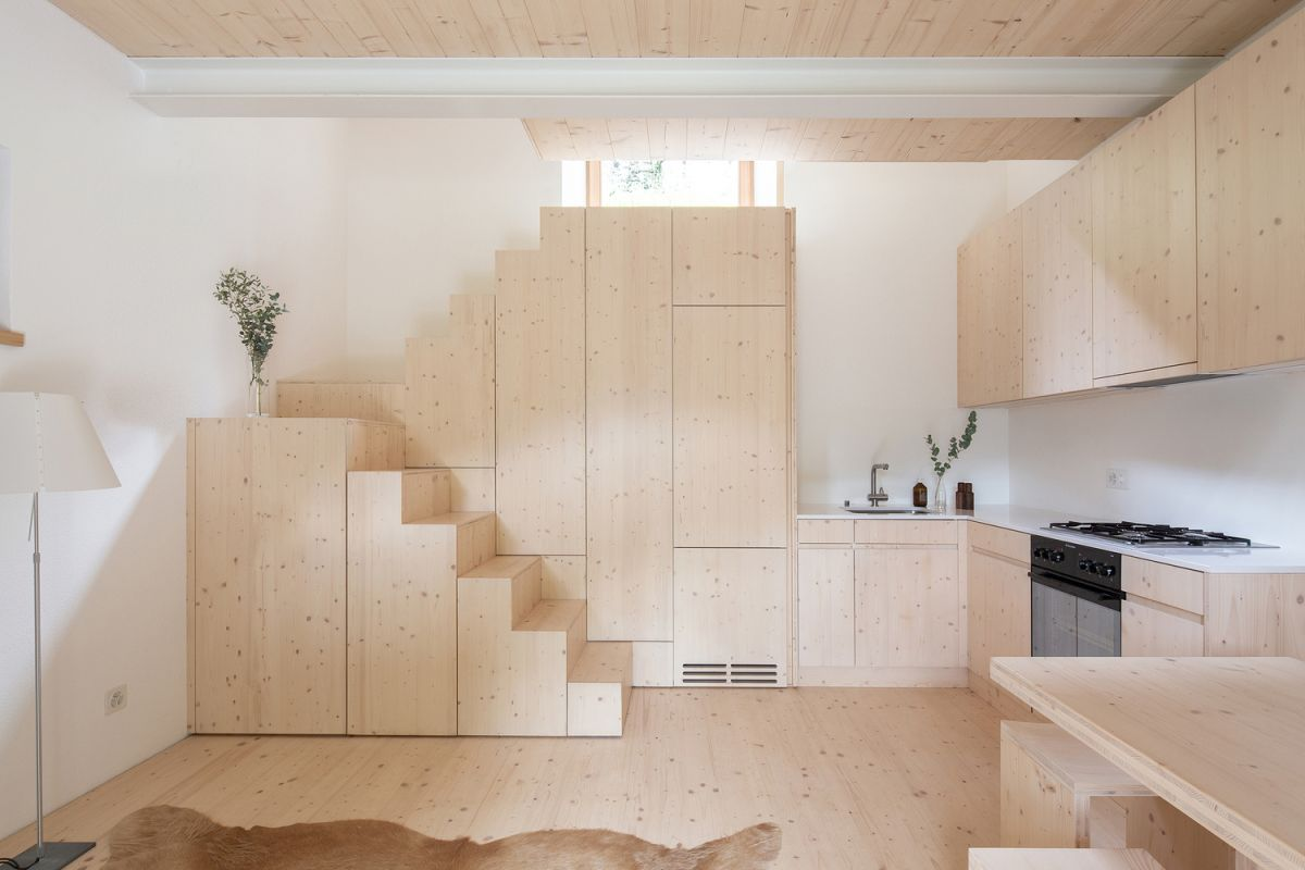The staircase which connects the common and private areas doubles as a storage unit
