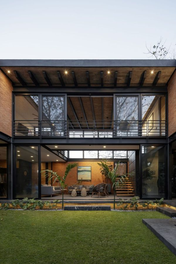 The ground floor living room and the space above it open beautifully onto a backyard