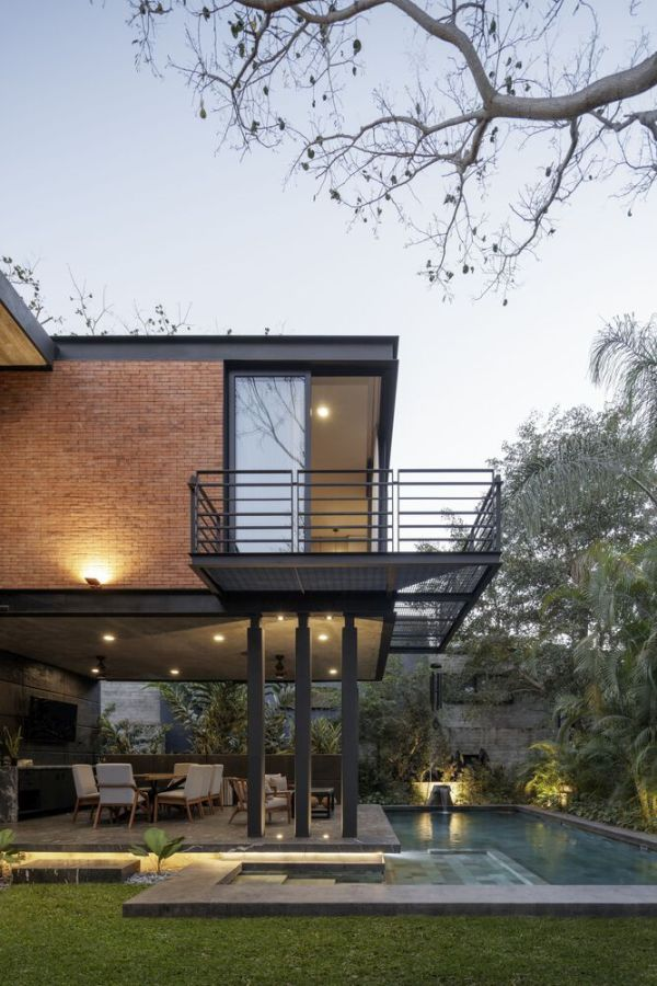 A corner balcony mimics the placement of the swimming pool below it