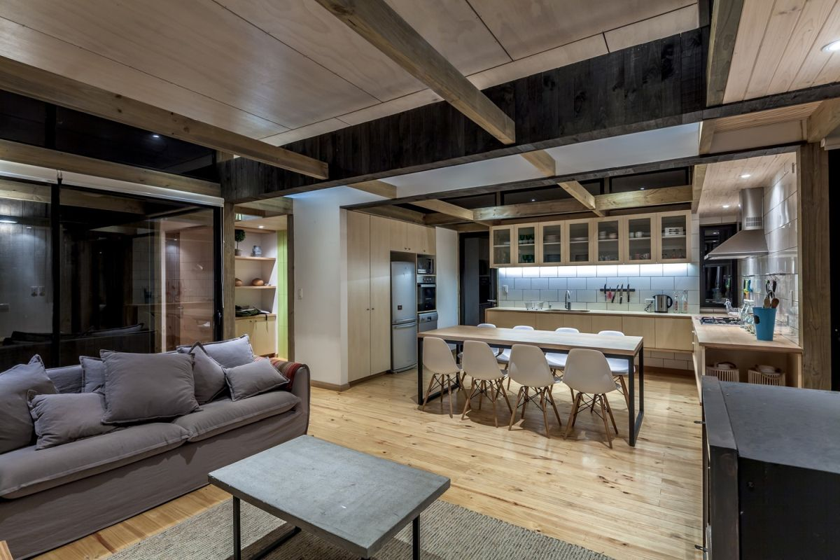 Although they're part of the same space, the living room and kitchen areas maintain their separate identities