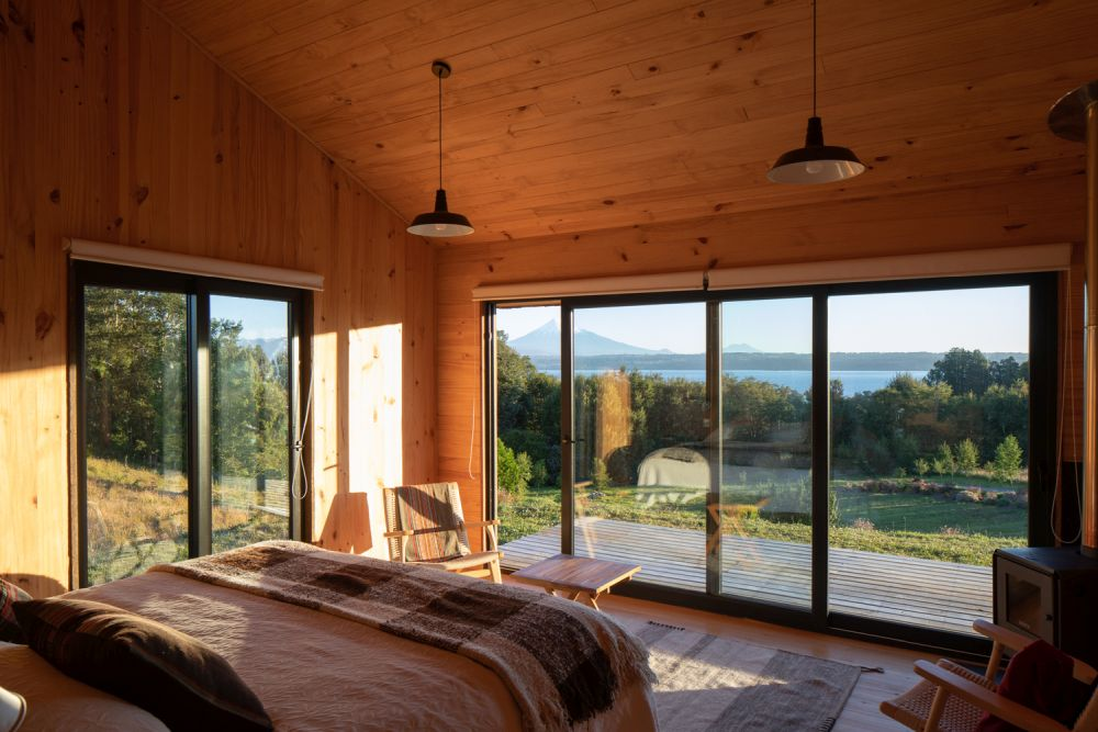 Large windows and sliding glass doors allow easy access in and out and welcome the outdoors in