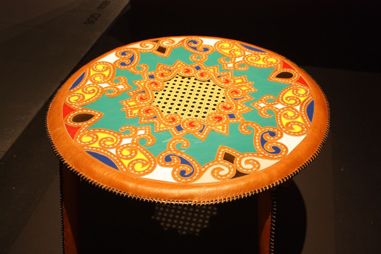 This table is an excellent example of the colors and masterful craftsmanship of the leatherwork in the collection. The stunning detail in this table would be a conversation piece in any setting.