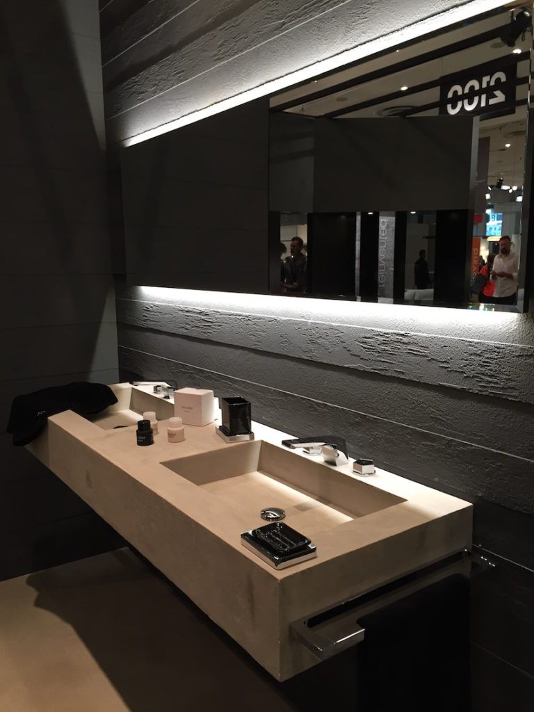 Concealed lighting, like this example under the mirror, adds ambiance without casting harsh light.