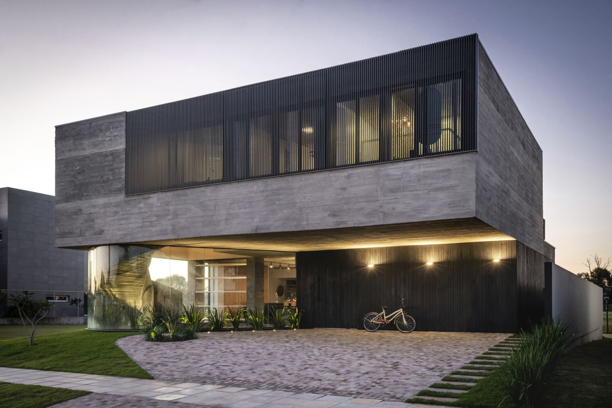 warm accent lights emphasize the simple and modern geometry of the house at night