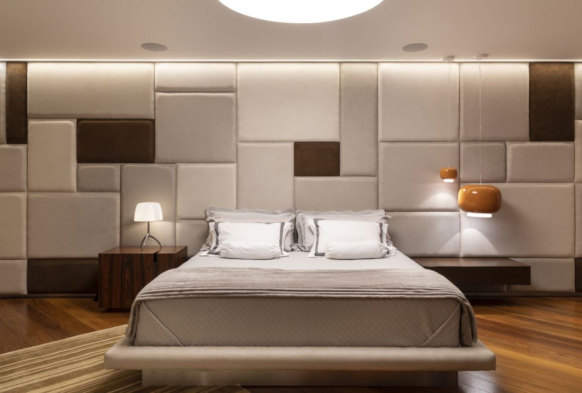 The master bedroom features an accent wall which is basically a giant headboard