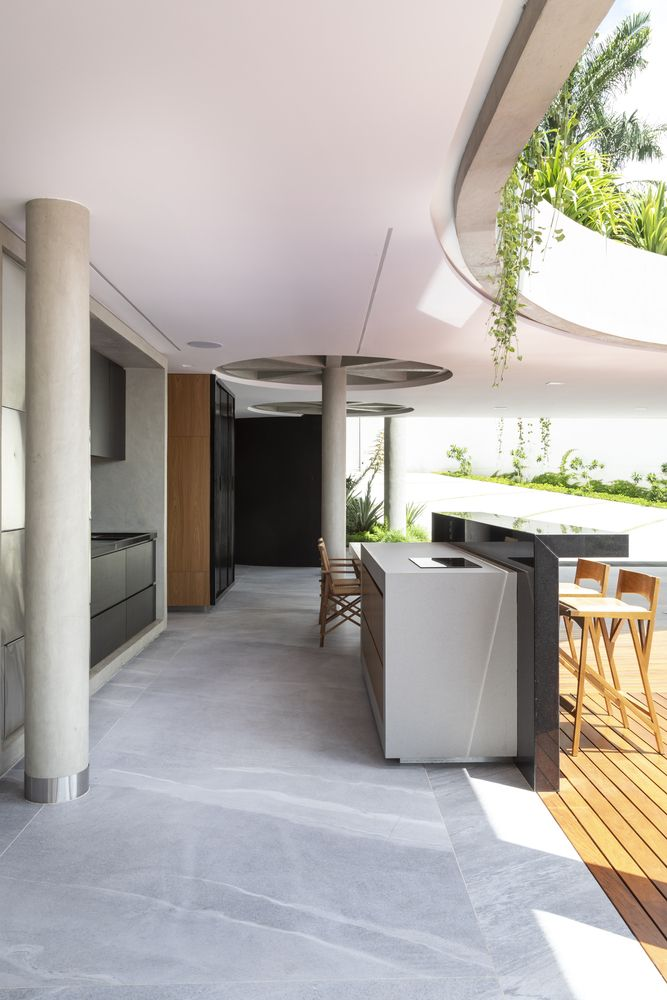 There's a transitional area between the kitchen and the pool where a barbecue grill area is set up