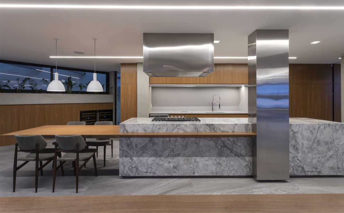 The choice of materials and finishes aims to create a timeless aesthetic throughout the residence