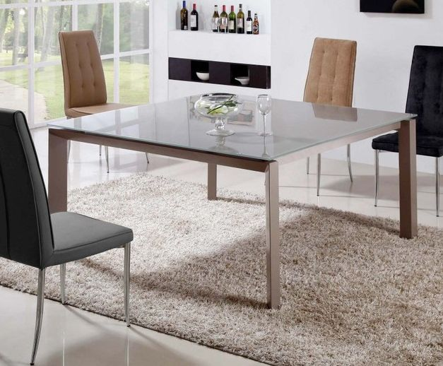 Contemporary dining table with glass on top