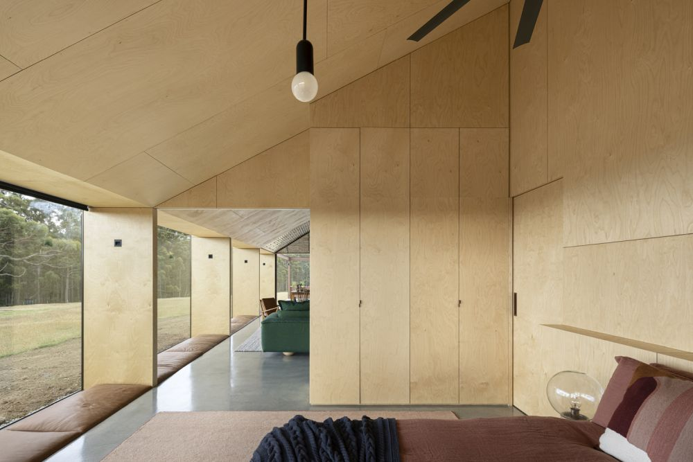 In-ground beds line the windows in the living area as well as the bedroom