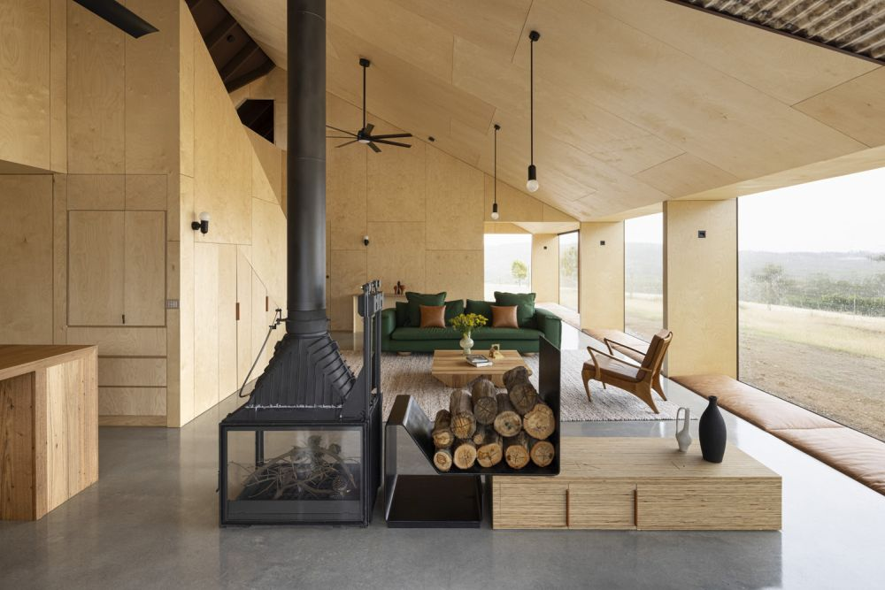 At the center of the living area is a wood-burning fireplace