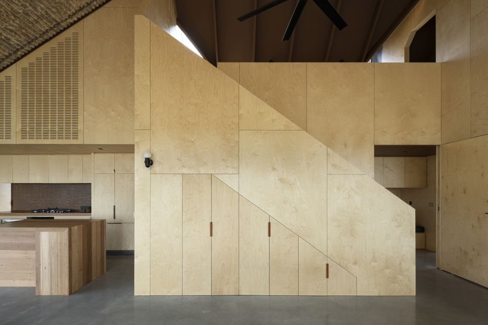 The simple palette of materials used for the interior includes concrete, plywood and wool