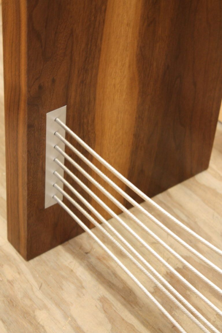A close-up of how elegantly the cables are attached to the side of the table.