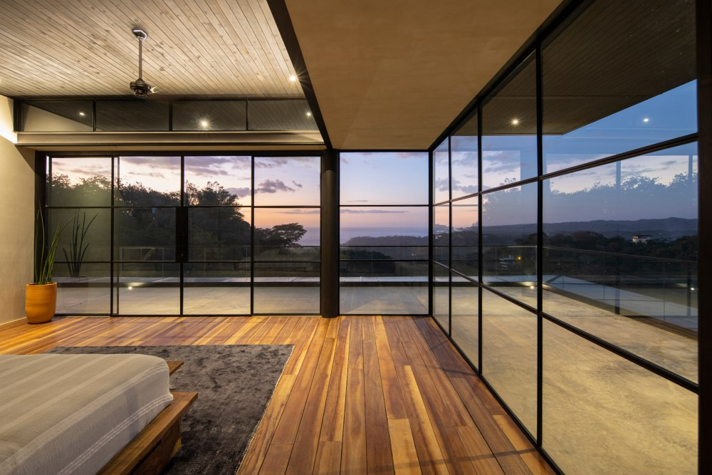 The bedrooms have access to their own spacious terraces and get to frame views of the ocean and the mountains