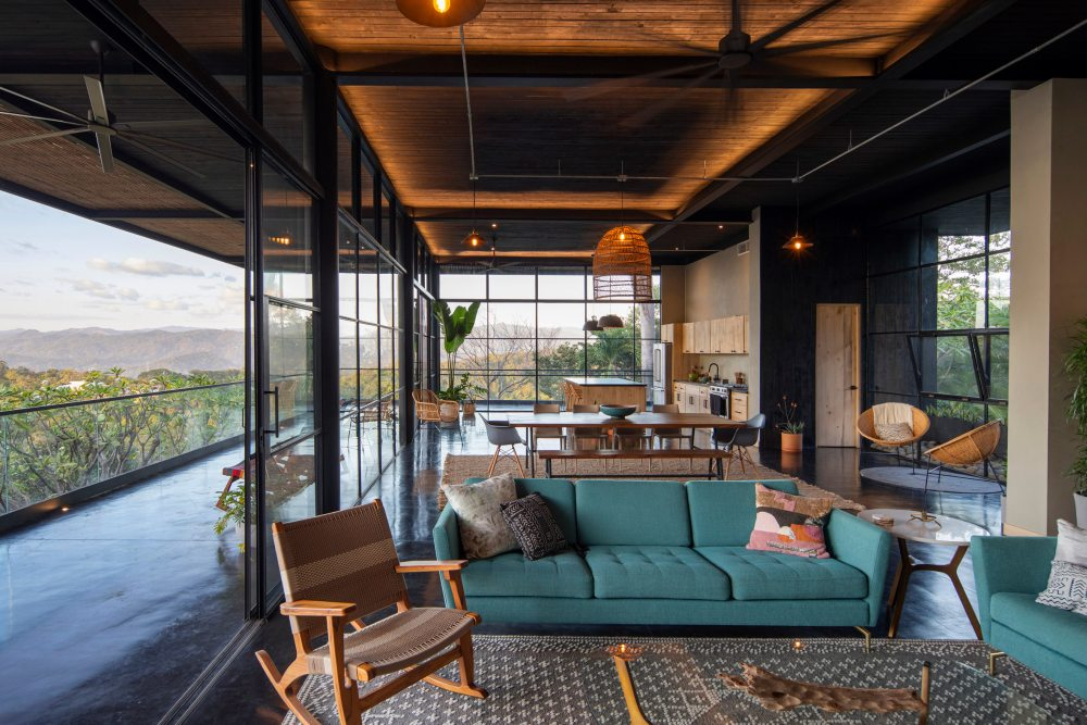 The exterior charred wood cladding is complemented by a warm and inviting interior color palette