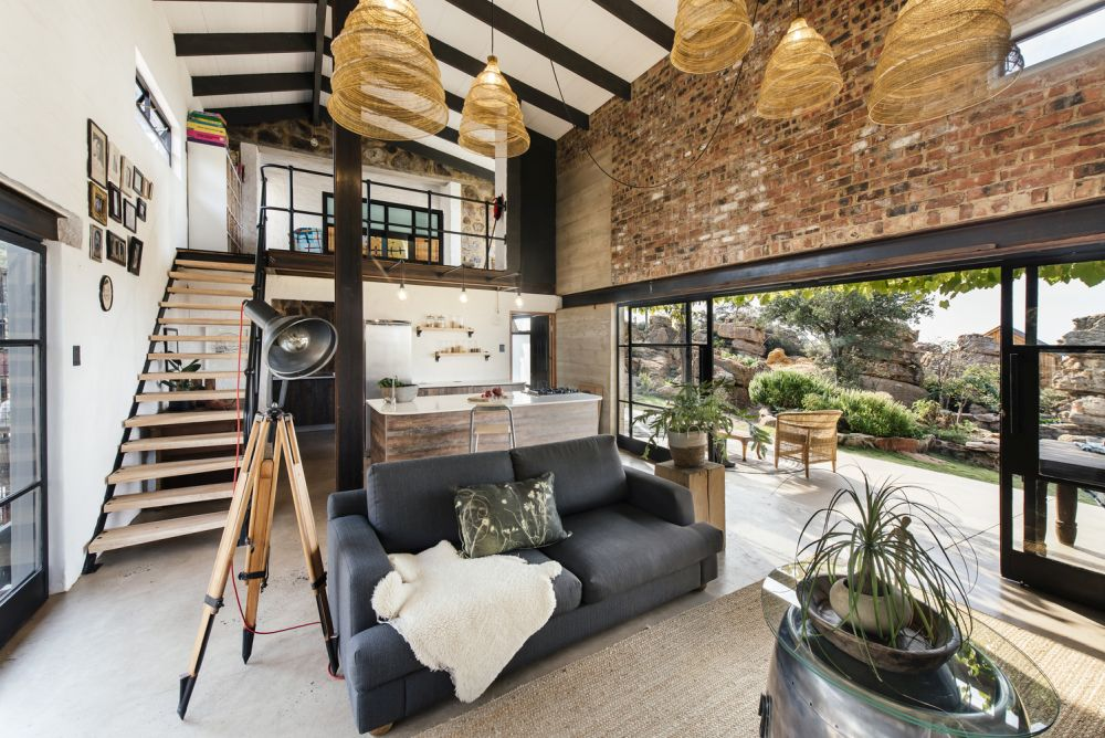 The double-height living area opens onto a deck with a really nice view