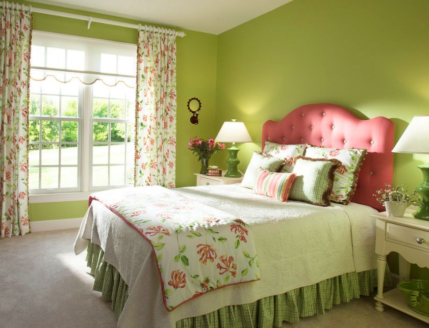 While the green surrounds the bedroom with freshness, the pink accents add a feminine touch to the room