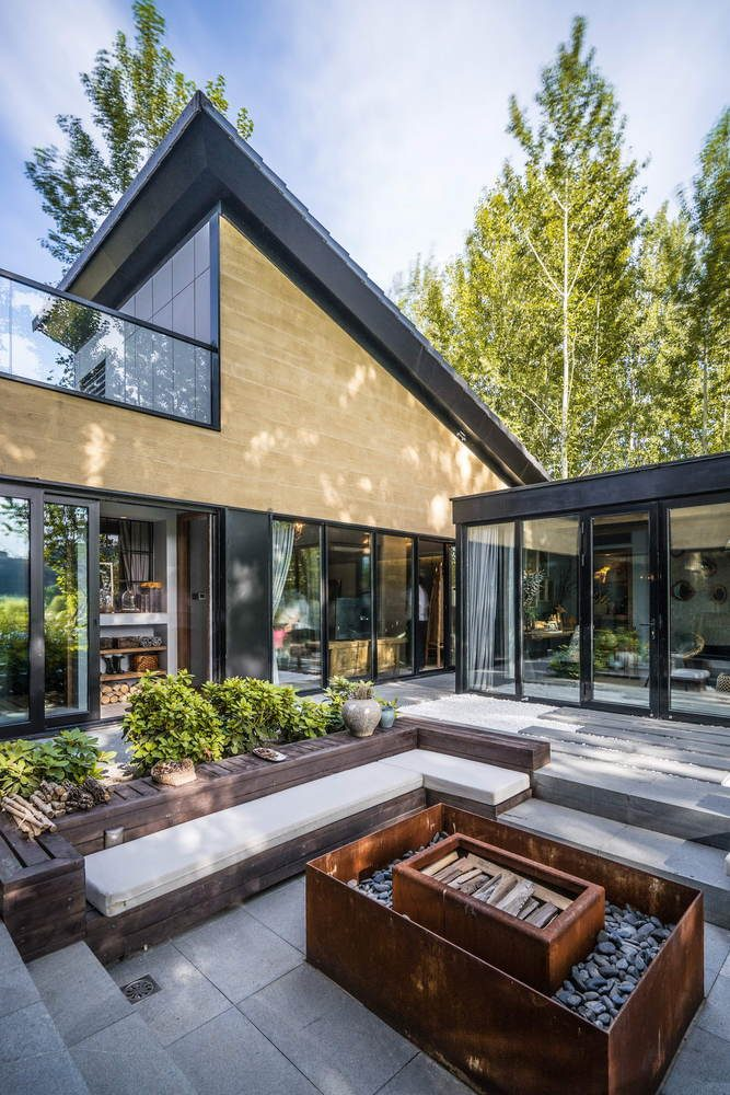 The Corten steel accents suit the eclectic style of the house and its surroundings