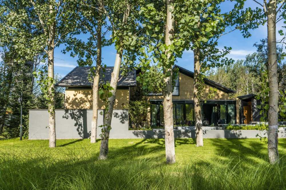 The exterior color palette helps the house to blend in with the surrounding landscape