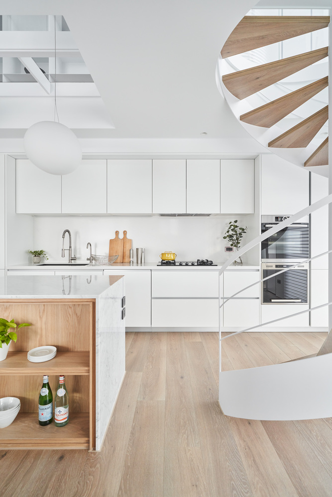 Wood and marble are used as accent materials in areas such as the kitchen