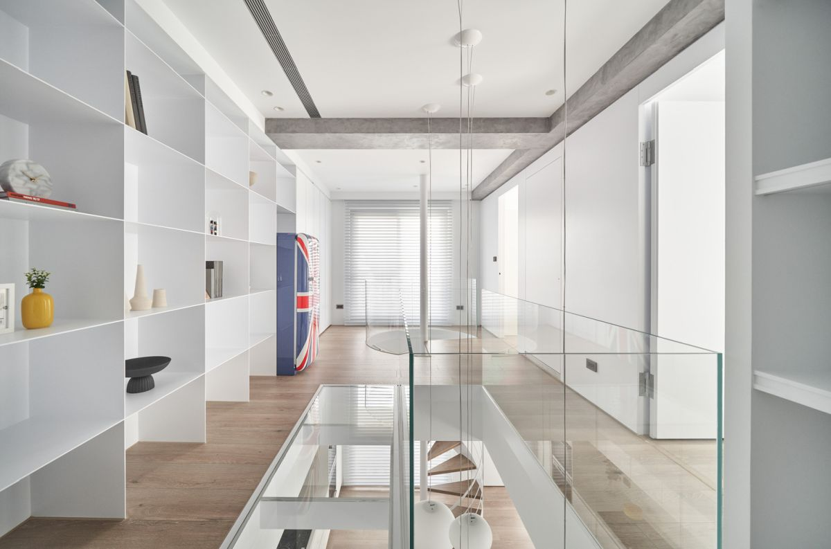 White open shelves along the wall give this hallway a very open and airy feel