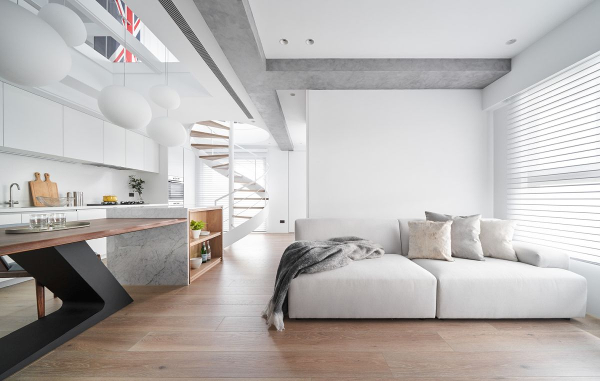 The ceiling beam is grey and has a concrete texture which adds diversity to the decor