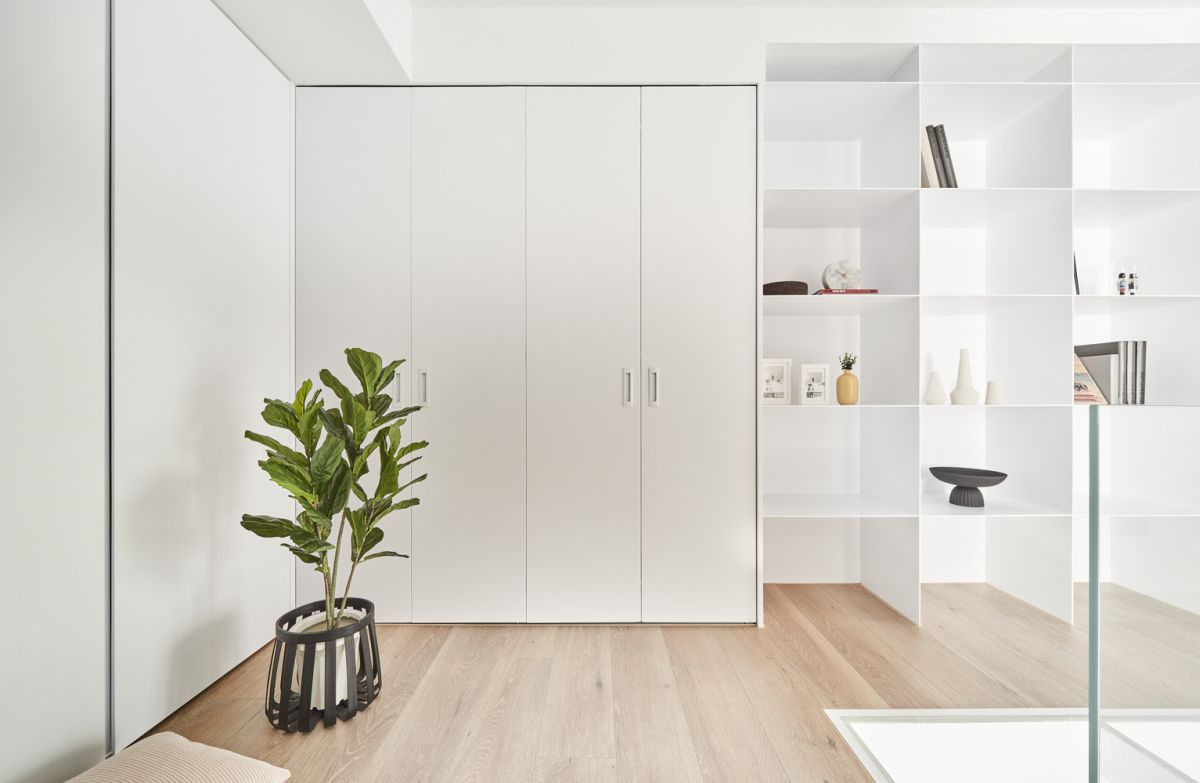 The white storage cabinets and shelves blend in with the walls behind them, giving the impression of a larger space around them