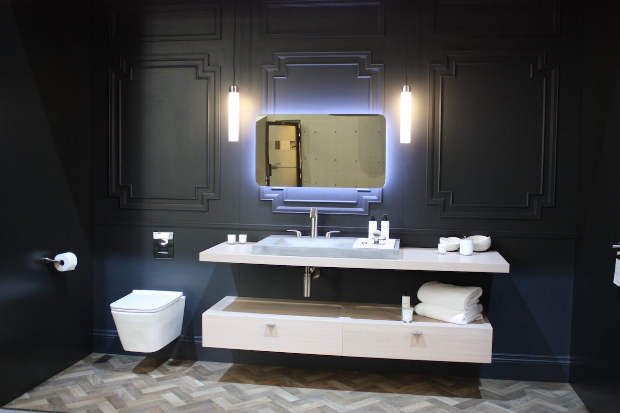 Pendants can serve the same function as sconces by the mirror.