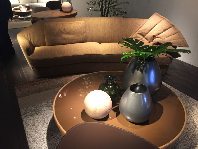 Decorate the coffee table with empty metalic vases