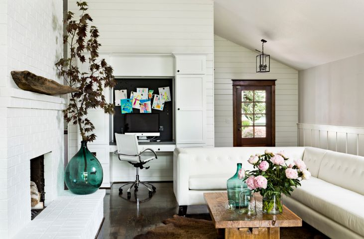 Decorate the white brick fireplace with a turquoise flower vase