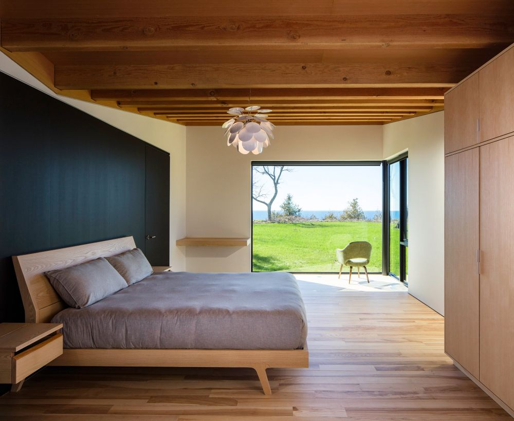 The bedroom has its own gorgeous view with adjacent windows which bring in light and color