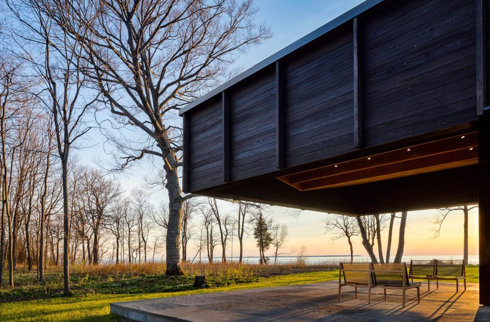 The covered outdoor terrace is the perfect viewing spot from where to admire the lake