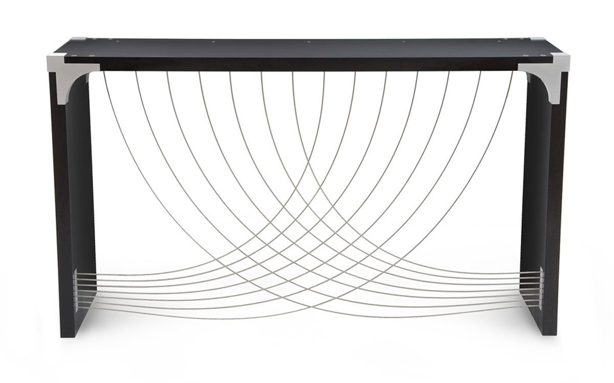 The Divergence table uses an exposed aluminum corner bracket. The sweeping curves of the cablesevoke movement.