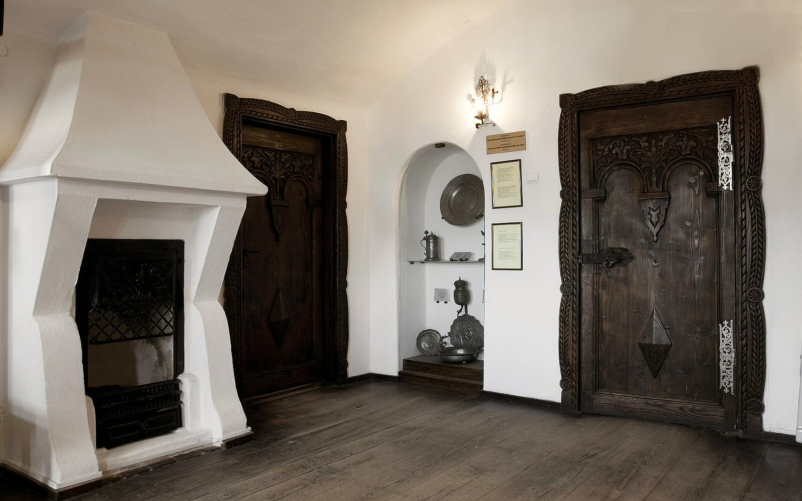 The living quarters are decorated in a more welcoming manner. using a lot of wood
