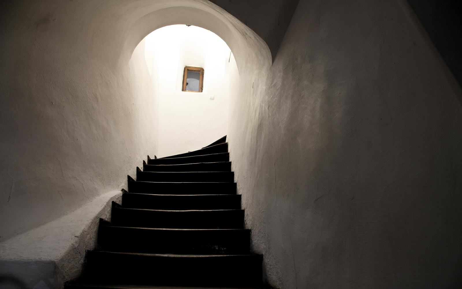 Staircases with walls and ceilings that curve around them link the various floors